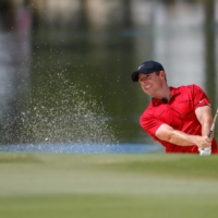 Rory McIlroy plays a shot from a bunker on the second hole during the final round of the Workday Championship on Sunday in Bradenton, Florida. | USA TODAY / VIA REUTERS