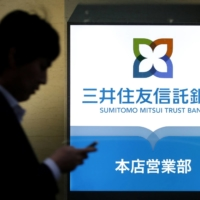 Sumitomo Mitsui Trust Bank Ltd. and other big trust banks profit from their stock transfer agent businesses, industry sources say. | BLOOMBERG