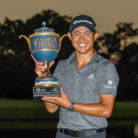 Colin Morikawa poses with the trophy after winning the Workday Championship on Sunday in Bradenton, Florida. | USA TODAY / VIA REUTERS