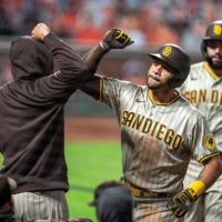 The Padres' Tommy Pham (right) is congratulated after hitting a two-run home run against the Giants in San Francisco on Sept. 26, 2020.   USA TODAY / VIA REUTERS