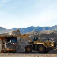 A wheel-loader operator fills a truck with ore at the MP Materials rare earth mine in Mountain Pass, California. | REUTERS