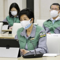 Tokyo Gov. Yuriko Koike is voicing concerns that the number of newly infected cases has not slowed enough for the coronavirus state of emergency to be lifted as scheduled. | KYODO