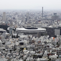The new National Stadium in Tokyo's Shinjuku Ward. The fate of the Tokyo Games remains in doubt due to concerns over holding such a wide-scale event in a world reshaped by the pandemic. | BLOOMBERG