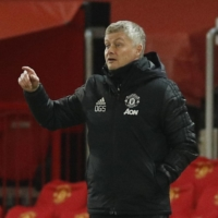 Manchester United's Ole Gunnar Solskjaer directs his team during a Europa League match at Old Trafford in Manchester, England, on Feb. 25. | REUTERS