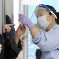 Japan adds 13 nations for extra quarantine steps over COVID-19 variants