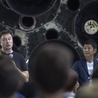 Elon Musk speaks at a news conference along with Yusaku Maezawa at SpaceX's headquarters and rocket factory in Hawthorne, California, in September 2018. | AFP-JIJI