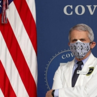National Institute of Allergy and Infectious Diseases Director Dr. Anthony Fauci stands by during an event to mark the milestone of 50 million COVID-19 vaccine doses being administered in the U.S., during an event at the White House on Feb. 25.  | REUTERS