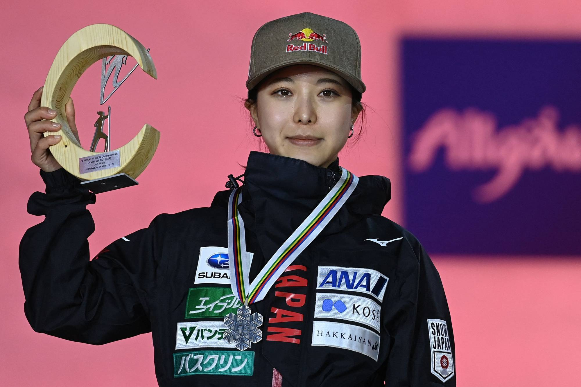 Sara Takanashi holds her trophy on the podium after finishing second in the women's large hill jumping event at the FIS Nordic Ski World Championships in Oberstdorf, Germany, on Wednesday. | AFP-JIJI