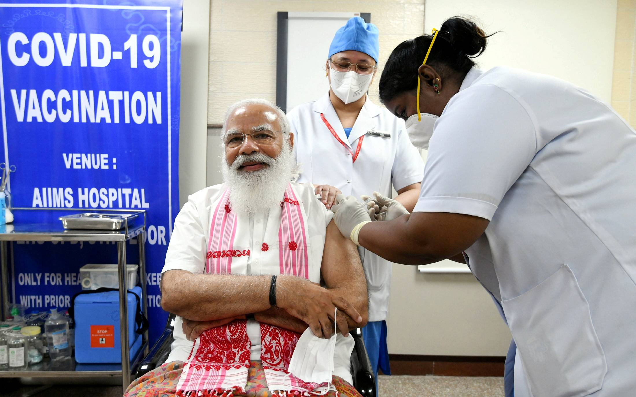 Indian Prime Minister Narendra Modi receives a dose of Covaxin, a COVID-19 vaccine developed by India's Bharat Biotech and the state-run Indian Council of Medical Research, at a hospital in New Delhi on Monday.   INDIA'S PRESS INFORMATION BUREAU / VIA REUTERS