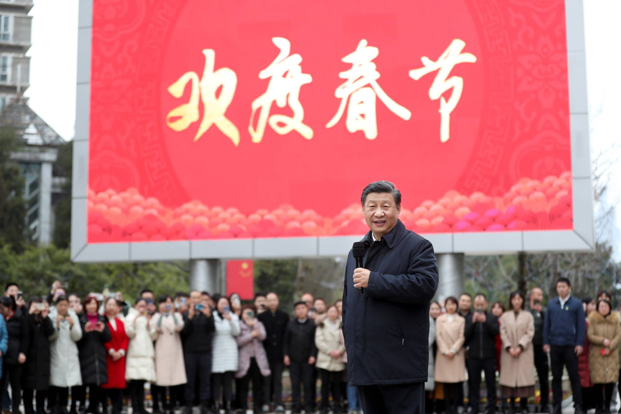 Chinese President Xi Jinping meets with local residents in the Guanshanhu District of Guiyang, the capital of southwest China's Guizhou Province, on Feb. 4.   XINHUA /GETTY IMAGES / VIA BLOOMBERG