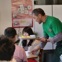 A helping hand: Before the COVID-19 pandemic hit Japan, Ken Watanabe would visit Kesennuma, Miyagi Prefecture, once a month to help run and serve customers at K-port, a cafe he opened so that the local community would have a place to gather after the March 11 disaster. | K-DASH / VIA KYODO