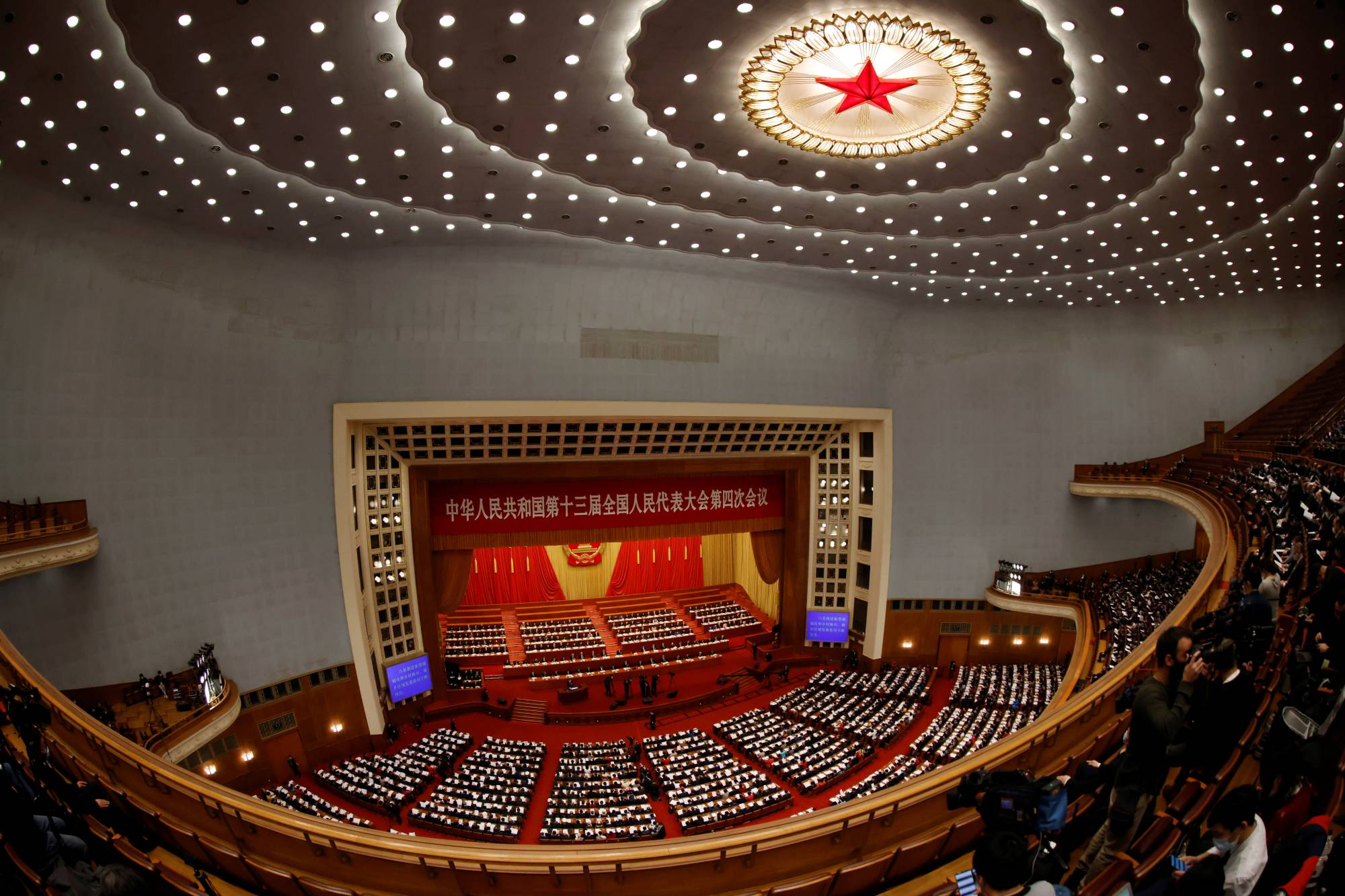 Chinese leaders and delegates attend the opening session of the National People's Congress at the Great Hall of the People in Beijing on Friday. | REUTERS