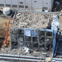Part of the Fukushima No. 1 nuclear plant is seen in ruins on March 24, 2011. | AIR PHOTO SERVICE / VIA REUTERS