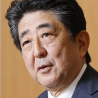 Former Prime Minister Abe reflects on his administration's role in postdisaster reconstruction