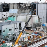 Tokyo Electric Power Co. discloses its debris clearing work to the press at the Fukushima Daiichi nuclear power plant's No. 3 reactor on Sept. 4, 2015, ahead of the four and a half year mark of the 2011 disaster. | KYODO