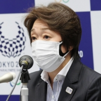 Seiko Hashimoto, president of the Tokyo Olympic and Paralympic organizing committee, speaks during a news conference in Tokyo on Friday. | POOL / VIA KYODO