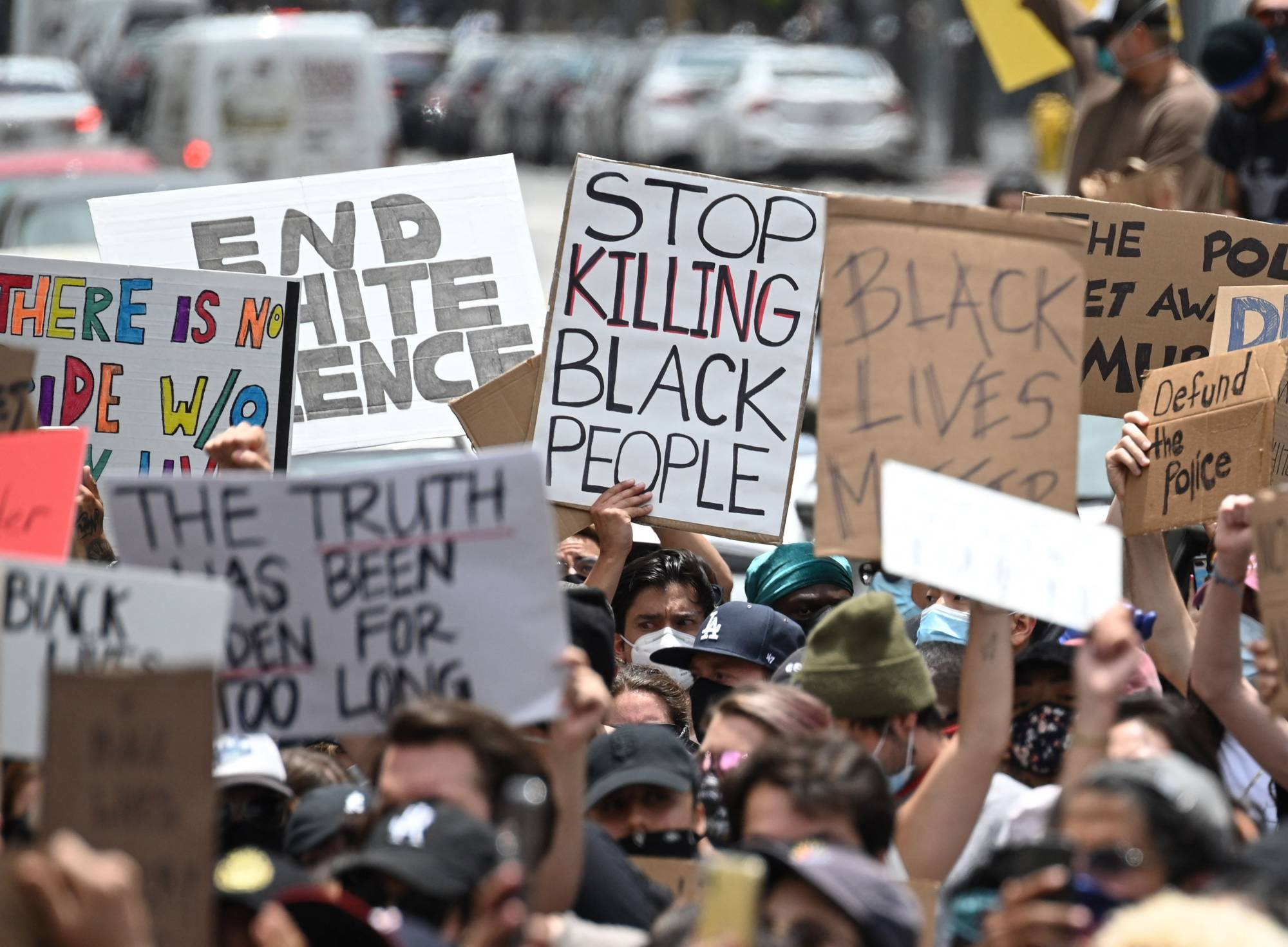 Demonstrators march through the streets of Hollywood, California, to protest the death of George Floyd at the hands of police last June.   AFP-JIJI