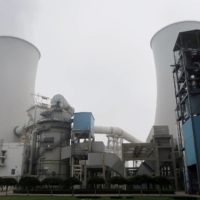 Water vapor rises from a cooling tower of a China Energy ultralow emission coal-fired power plant during a media tour, in Sanhe, Hebei province, in July 2019. | REUTERS