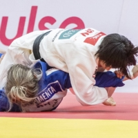 Uta Abe (top) competes during the semifinals of the women's 52-kg division at the Tashkent Grand Slam on Friday. | KYODO