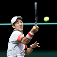 Kei Nishikori hits a return against Borna Coric during their quarterfinal match at the ABN AMRO World Tennis Tournament on Friday in Rotterdam, Netherlands. | REUTERS
