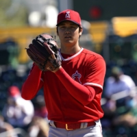 Angels starter Shohei Ohtani pitches against the A's during a spring training game in Mesa, Arizona, on Friday. | USA TODAY / VIA REUTERS
