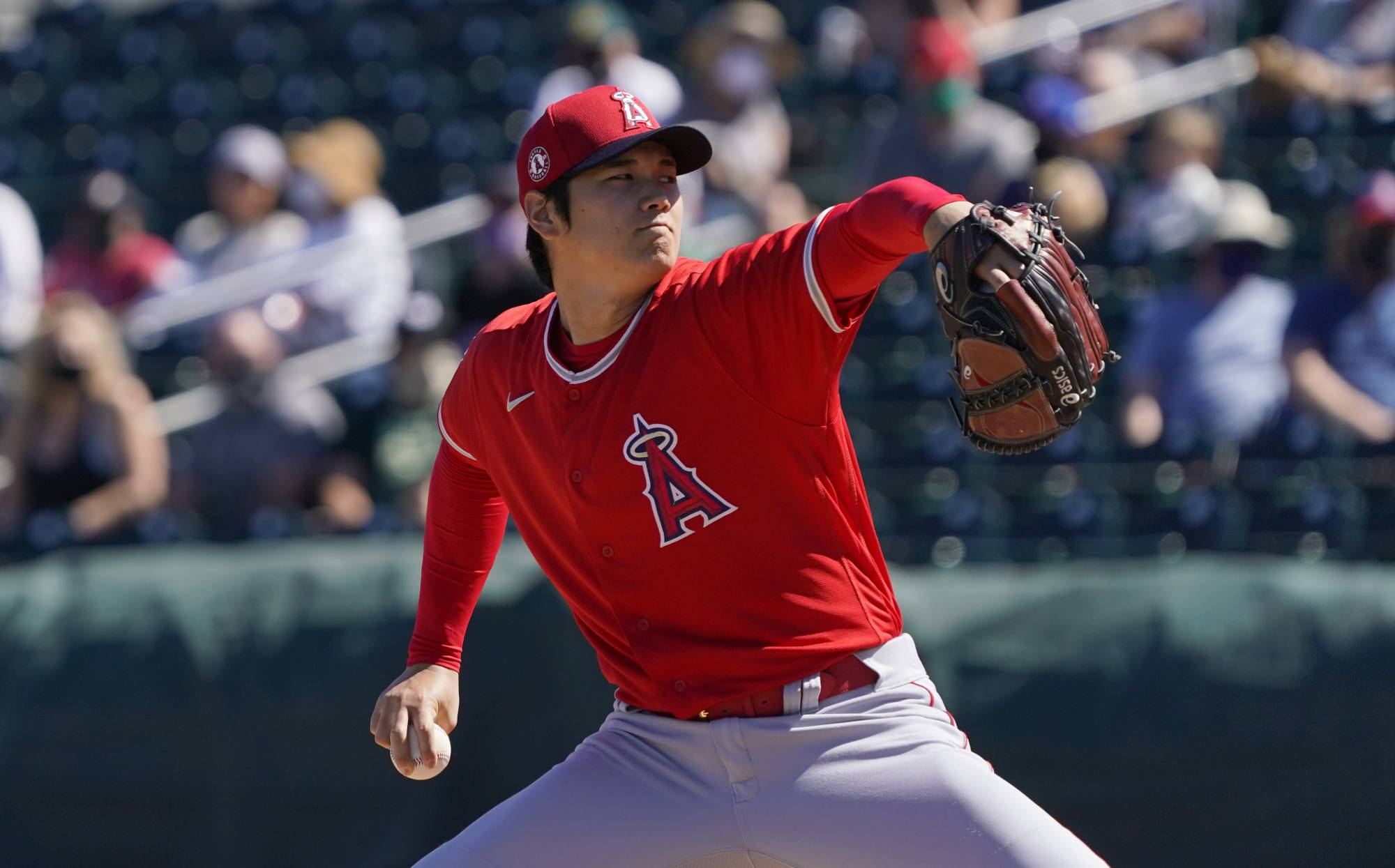 The Angels' Shohei Ohtani pitches against the A's during a spring training game in Mesa, Arizona, on Friday. | USA TODAY / VIA REUTERS