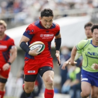 Yamaha's Ayumu Goromaru scores a try against NEC during his first Top League game of the season on Saturday at Chichibunomiya Rugby Ground.  | KYODO