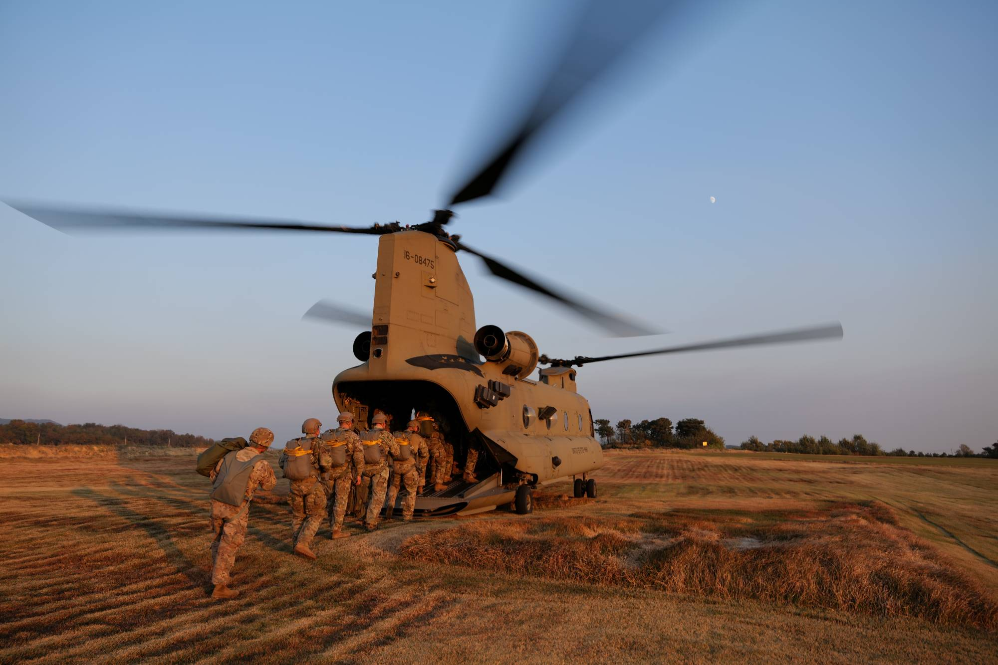 Members of South Korea and U.S. Special forces board a CH-47 Chinook helicopter during a joint military exercise in Gangwon province, South Korea, in November 2019.  | U.S. AIR FORCE / VIA REUTERS