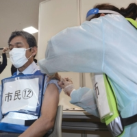 Japan's local governments worried about lack of vaccine info from state