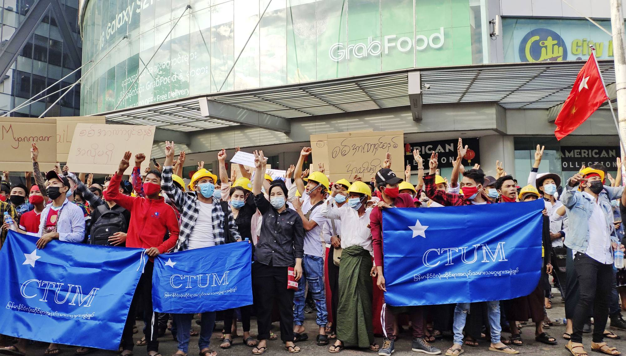 Workers in Yangon, Myanmar, protest against the military coup last month.  | KYODO