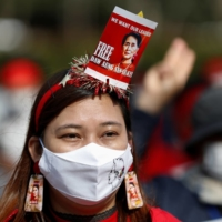 A demonstrator protests against the military coup in Myanmar on February 14 in Tokyo.  | REUTERS