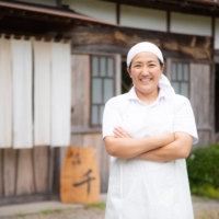 A unique taste: Chiyo Shibata stands in front of Fromage Sen, her cheesery in Chiba Prefecture.  | COURTESY OF FROMAGE SEN