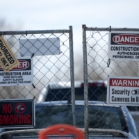 Signs outside the Gambit Energy Storage Park under construction in Angleton, Texas | BLOOMBERG