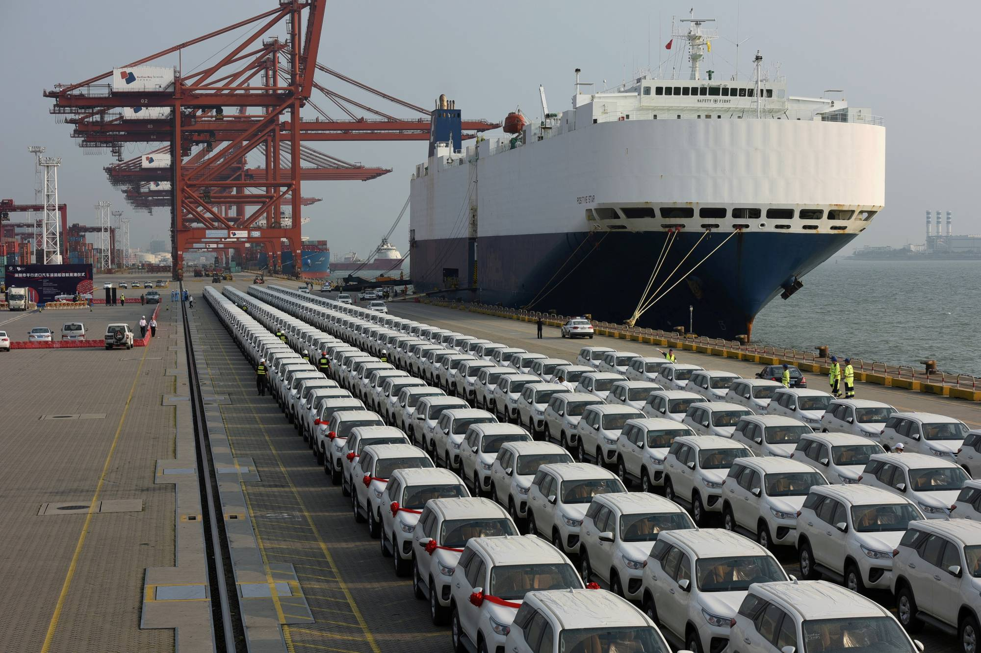 Imported Toyota cars are unloaded from a cargo vessel at the Shenzhen Dachan Bay Terminals in China. Toyota has been largely unaffected by a global chip shortage. | REUTERS