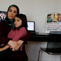 Nursiman Abdurasit with her daughter, Zehra, at her home in Istanbul on Monday | REUTERS