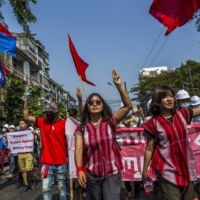 Esther Ze Naw and Ma Ei Thinzar Maung lead a rally to protest the recent military coup, in Yangon, Myanmar, on Feb. 6. | THE NEW YORK TIMES