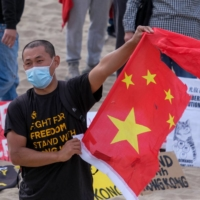 Demonstrators in California take part in a protest on March 7 to show  solidarity with the 47 pro-democracy activists in Hong Kong who were earlier charged with subversion. Indications the national security law has succeeded in instilling fear in Hong Kong may be encouraging Chinese President Xi Jinping to escalate repression in the once-defiant city.  | AFP-JIJI