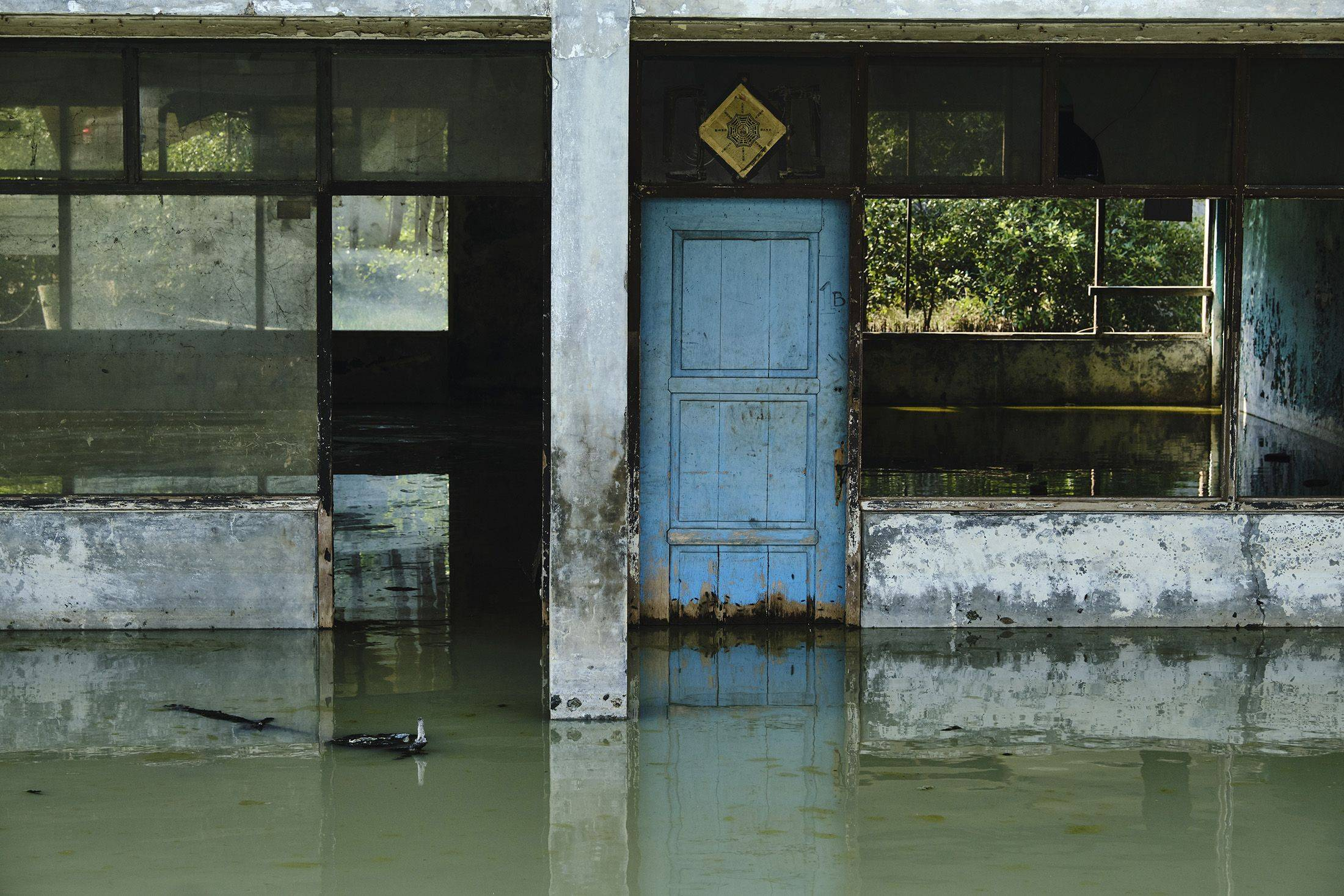 A warehouse sits abandoned after subsidence left it permanently flooded on in Jakarta.   GETTY IMAGES / VIA BLOOMBERG