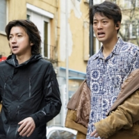 You're the bomb: Tatsuya Fujiwara (left) and Ryoma Takeuchi (right) play corporate spies whose employers have implanted explosives in their chests to stop them from going rogue. | © SHUICHI YOSHIDA / GENTOSHA © 2020 'THE SUN STANDS STILL' FILM PARTNERS