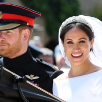 Britain's Prince Harry, the Duke of Sussex, and his wife Meghan, the Duchess of Sussex, after their wedding ceremony in 2018.  | AFP-JIJI