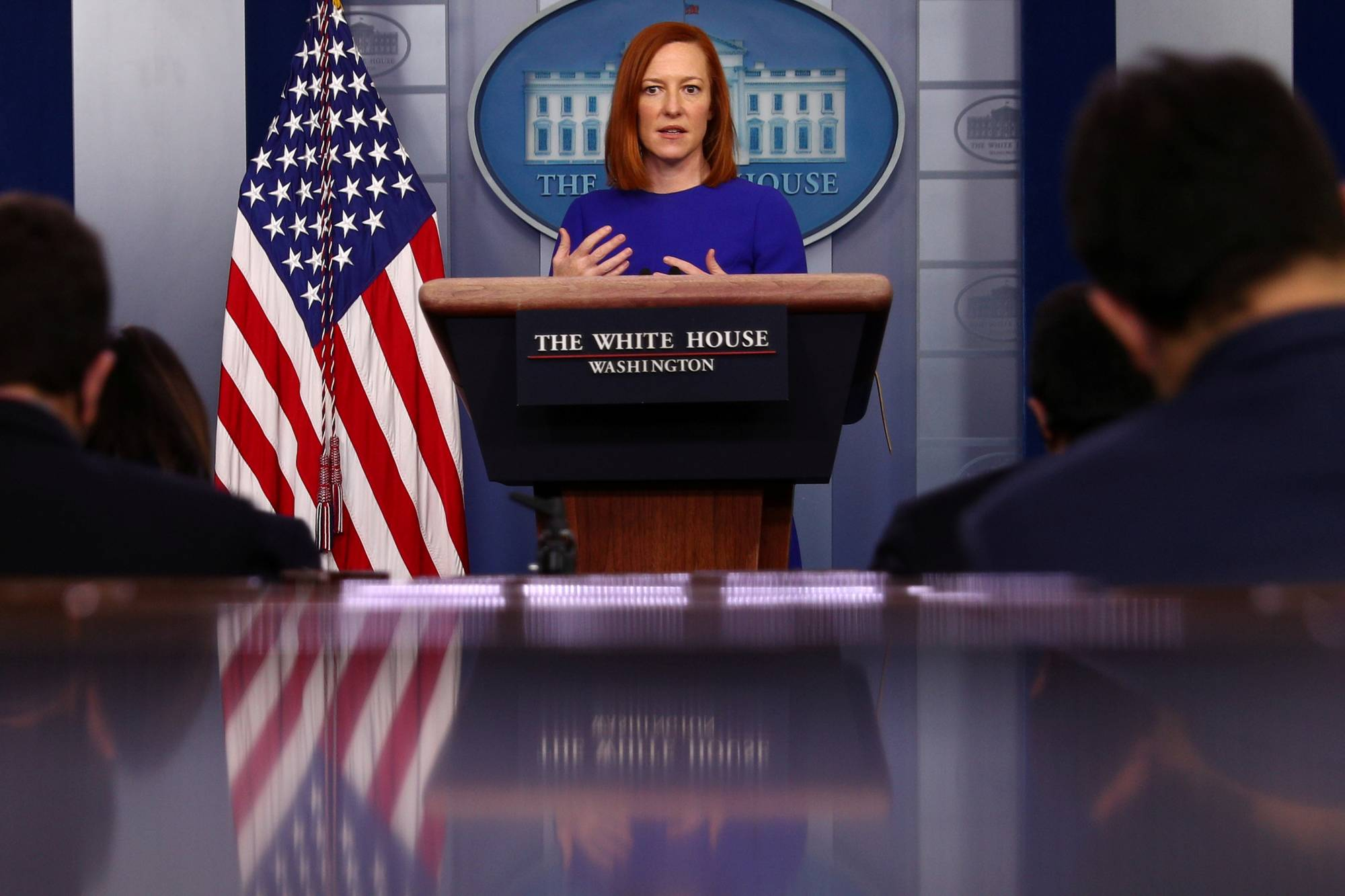 White House press secretary Jen Psaki delivers remarks during a briefing at the White House on Tuesday. | REUTERS