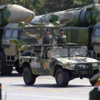 Military vehicles carrying DF-21D ballistic missiles move toward Tiananmen Square in Beijing during a military parade marking the 70th anniversary of the end of World War II in September 2015.   REUTERS