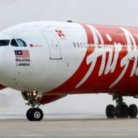 Crunched by border restrictions in Southeast Asia, low-cost airline AirAsia Group Bhd. is front loading its revenue recovery by selling 599-ringgit ($146) travel passes that allow unlimited flights in Malaysia and the ASEAN region for a year. | REUTERS