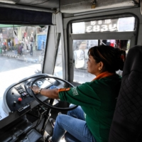 As part of moves to make public transport greener, women have been driving hundreds of electric three-wheeled, 12-seater buses for the past 25 years in Kathmandu. | AFP-JIJI