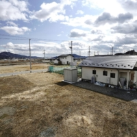 Land developed in Rikuzentakata, Iwate Prefecture, after a huge tsunami devastated the city in 2011 remains mostly vacant in a picture taken on Saturday. | KYODO