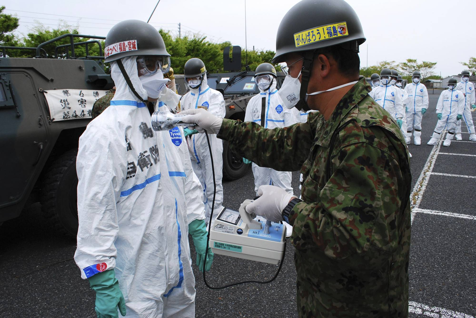 Self-Defense Force personnel are screened for radiation in Minamisoma, Fukushima Prefecture, after searching for bodies in the area soon after the March 11, 2011, earthquake and tsunami. It is estimated that the military was responsible for 70% of the persons rescued after the event.     | GSDF / VIA   REUTERS
