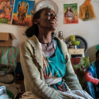 Beyenesh Tekleyohannes cries in her house with a group of relatives in the village of Dengolat, Ethiopia, on Feb. 26.  | AFP-JIJI