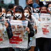 Demonstrators in Tokyo march to protest against the military coup in Myanmar, in mid February. | REUTERS