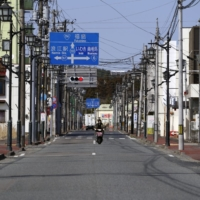Downtown Namie, Fukushima Prefecture, is quiet on Tuesday. Less than 10% of its residents have returned to live there after being evacuated a decade ago. | BLOOMBERG