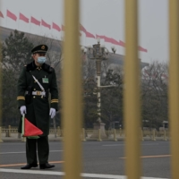 A paramilitary policeman stands guard outside the Great Hall of the People in Beijing on Wednesday. | AFP-JIJI